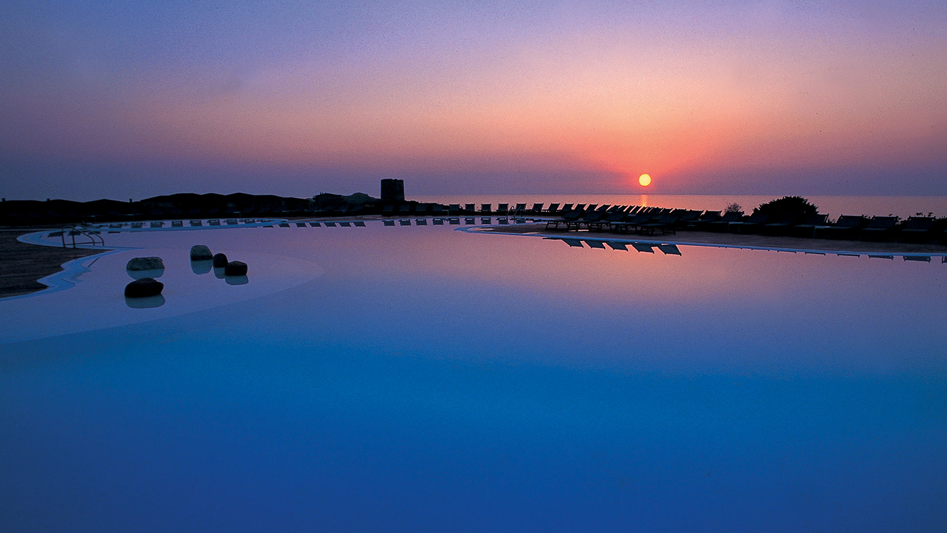 hotel-torreruja-slider-piscina-isola-rossa